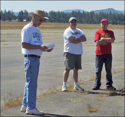 CD Tom Strom Sr. Briefs the Pilots. Pilots Eric Ide and Steve Mortenson.