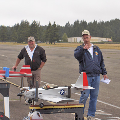 Tom Strom Sr., CD, Conducts Pilot Meeting. Pilot Dan Nalley