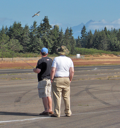 Flight Testing. Olympic Mountains In The Background.